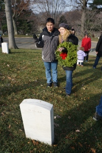 Huan chooses where to place his wreath.
