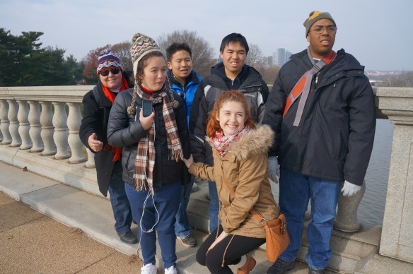 We decide to avoid the metro lines and walk into DC to catch the metro there! We pause for a group photo on the Memorial Bridge.
