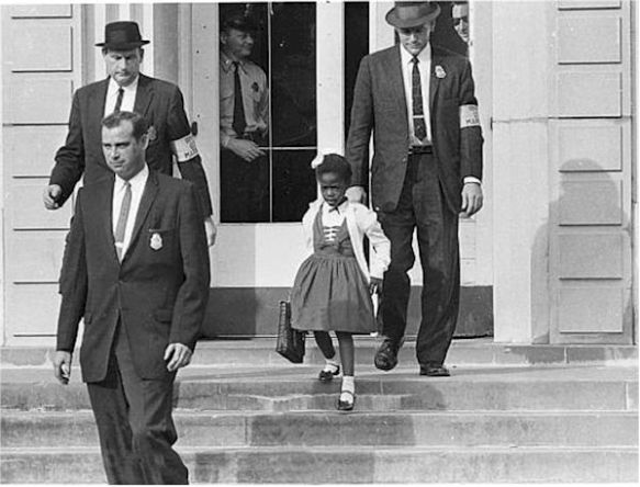 US Marshals with young Ruby Bridges on school steps.
